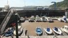 La arena invade la dársena del puerto de Candás