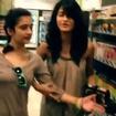 Shruti Haasan and Akshara Haasan singing at a store